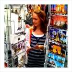 Nicole shopping for postcards in Paris.