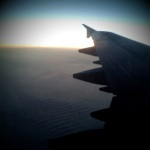 A view of our planes wing as we fly home to Helsinki during the sunset.