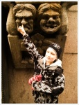 Aatu clowns around by picking the nose of a statue.