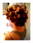 Emma's hair up in rollers.