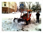 A mini tractor used for snow removal.