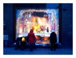 Pedestrians stop to take a look at the Stockmann holiday window display this Christmas.