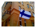 The flag flies on an apartment building in Helsinki.