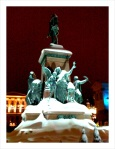 The statue of Emperor Alexander II is lit up on New Years.