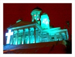Helsinki Cathedral is lit up in blue lights for New Years.