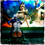 A street performer outside of Stockmann's department store plays the cello.